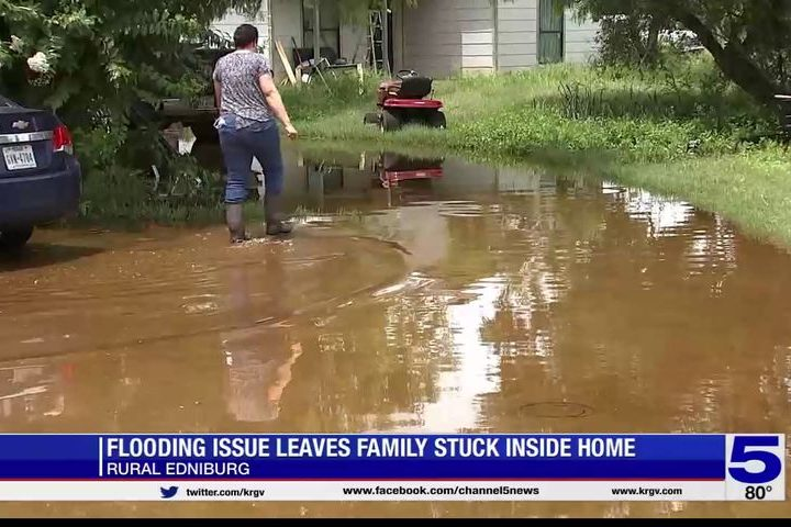 'The water doesn't go anywhere:' Flooding issues leave family stuck inside their home